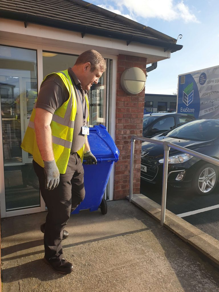 Gary collecting a shredding bin